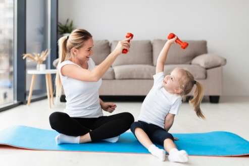 front-view-mother-child-exercising-with-weights-home_23-2148492541