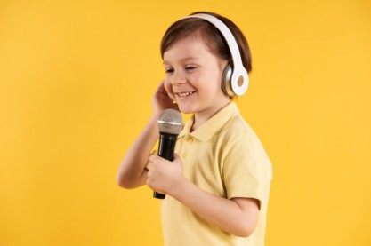 little-boy-headphones-sings-karaoke_99043-1600