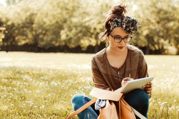 girl-nature-writing-notebook_109710-5322